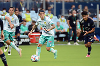 KANSAS CITY, KS - AUGUST 10: Omar Fernández #25 Club Leon with the ball during a game between Club Leon and Sporting Kansas City at Children's Mercy Park on August 10, 2021 in Kansas City, Kansas.