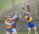 Owen Moore of Wexford in action against Niall Deasy and Seadna Morey of Clare during the Jack Lynch Memorial game at Tulla. Photograph by John Kelly.