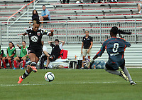 BOYDS, MARYLAND - July 21, 2012:  Lianne Sanderson (10) of DC United Women shoots past Marbel Egwuenu (0)  of the Virginia Beach Piranhas for a score that was called back for offside during a W League Eastern Conference Championship semi final match at Maryland Soccerplex, in Boyds, Maryland on July 21. DC United Women won 3-0.