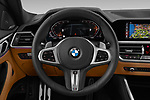 Car pictures of steering wheel view of a 2021 BMW 4-series M-Sport 2 Door Coupe Steering Wheel