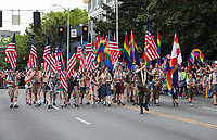 Boy scouts marching with rainbow and American flags, Seattle PrideFest 2015, Washington State, WA, America, USA.