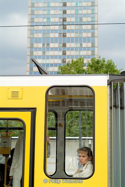 A passenger stares from a Berlin tram window in Alexanderplatz