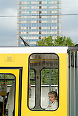 A passenger stares from a Berlin tram window in Alexanderplatz