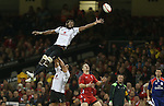 Wales wing George North waits to collect the restart ball as Fiji lock Leone Nakarawa fails to claim it.<br /> Dove Men Series 2014<br /> Wales v Fiji<br /> Millennium Stadium<br /> 15.11.14<br /> ©Steve Pope-SPORTINGWALES