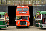 Pictured: James Freeman, Chairman of The Friends of King Alfred Buses reverses a red 1964 AEC Renown vintage bus no. 596, sandwiched between a green 1950 Leyland Olympic no. 708 and a 1959 Leyland Tiger no. 104 into the bus depot near Romsey, Hants during what would typically be a busy period leading up to the King Alfred Buses Running Day event, which has been cancelled this year due to the coronavirus pandemic. <br /> The annual event, usually held in May sees 20 heritage buses from as early as the 1950s providing free services through the city of Winchester and surrounding villages. <br /> <br /> The Friends of King Alfred Buses have taken the decision to cancel this years event, citing the effects of the coronavirus pandemic and the uncertainty around what kind of public events are permissible in the next few months. <br /> <br /> The vintage buses are still expected to play a part at Winchester Heritage Open Days in September of this year. <br /> <br /> © Jordan Pettitt/Solent News & Photo Agency<br /> UK +44 (0) 2380 458800