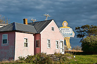 Pink house in fishing village, Winter Harbor, Maine, ME, USA
