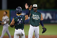 Charleston Boiled Peanuts relief pitcher Neraldo Catalina (35) slaps hands with catcher Michael Berglund (15) after closing out the game against the Augusta GreenJackets at Joseph P. Riley, Jr. Park on June 26, 2021 in Charleston, South Carolina. (Brian Westerholt/Four Seam Images)