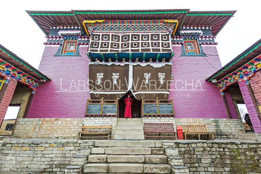 A monk in a doorway of the Tangboche Monastery also known as Dawa Choling Gompa is a Tibetan Buddhist monastery of the Sherpa community. Situated at 3,867 metres (12,687 ft), the monastery is the largest gompa in the Khumbu region, Nepal