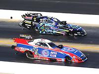 Oct 14, 2019; Concord, NC, USA; NHRA funny car driver Robert Hight (near) alongside Tim Wilkerson during the Carolina Nationals at zMax Dragway. Mandatory Credit: Mark J. Rebilas-USA TODAY Sports