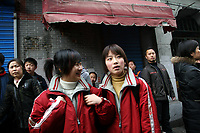 CHINA. Shanghai. Students outside a school in the old town. Shanghai is a sprawling metropolis or 15 million people situated in south-east China. It is regarded as the country's showcase in development and modernity in modern China. This rapid development and modernization, never seen before on such a scale has however spawned countless environmental and social problems. 2008