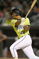 Second baseman Yoel Romero (26) of the Columbia Fireflies bats in a game against the Charleston RiverDogs on Thursday, April 4, 2019, at Segra Park in Columbia, South Carolina. Charleston won, 2-1. (Tom Priddy/Four Seam Images)