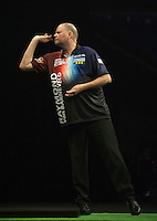 21.05.2015. London, England. Betway Premier League Darts Play-Offs.   Raymond van Barneveld [NED] in action during his semi final against Michael van Gerwen [NED]