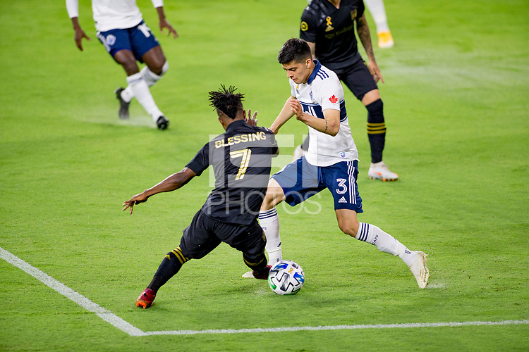 LOS ANGELES, CA - SEPTEMBER 23: Latif Blessing #7 of LAFC defended by Cristian Gutierrez #3 of the Vancouver Whitecaps during a game between Vancouver Whitecaps and Los Angeles FC at Banc of California Stadium on September 23, 2020 in Los Angeles, California.