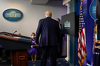 United States President Donald J. Trump leaves a news conference in the Brady Press Briefing Room of the White House in Washington, D.C., U.S., on Friday, May 22, 2020. Trump didn't wear a face mask during most of his tour of Ford Motor Co.'s ventilator facility Thursday, defying the automaker's policies and seeking to portray an image of normalcy even as American coronavirus deaths approach 100,000. <br /> Credit: Andrew Harrer / Pool via CNP/AdMedia
