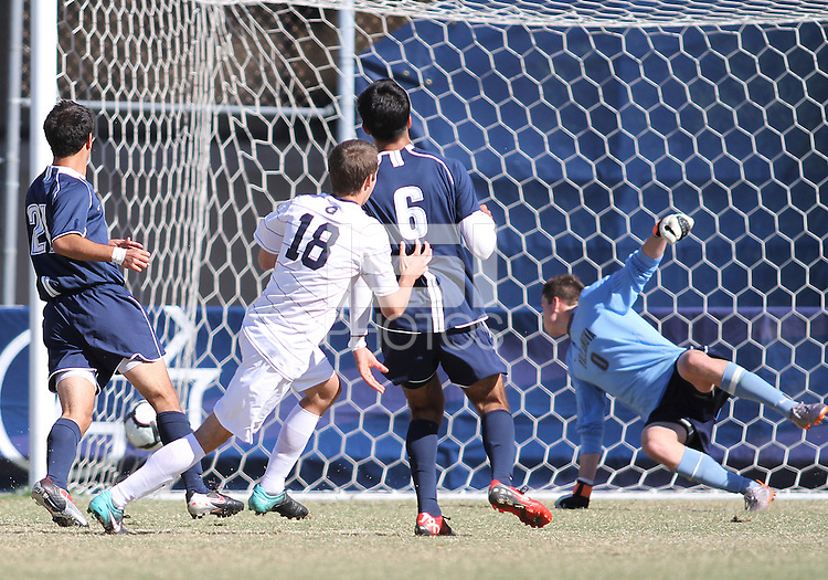 Steve Neumann #18 of Georgetwn University sends the ball past Chris Bresnahan #0 of Villanova University for the winning goal during a Big East match at North Kehoe Field, Georgetown University on October16 2010 in Washington D.C. Georgetown won 3-1.