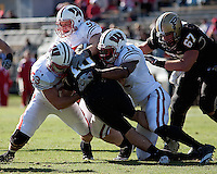 Wisconsin linebacker Mike Taylor (53), defensive tackle Patrick Butrym (95) and David Gilbert (11) tackle Purdue quarterback Sean Robinson (10). The Wisconsin Badgers defeated the Purdue Boilermakers 34-13 at Ross-Ade Stadium, West Lafayette, Indiana on November 6, 2010.