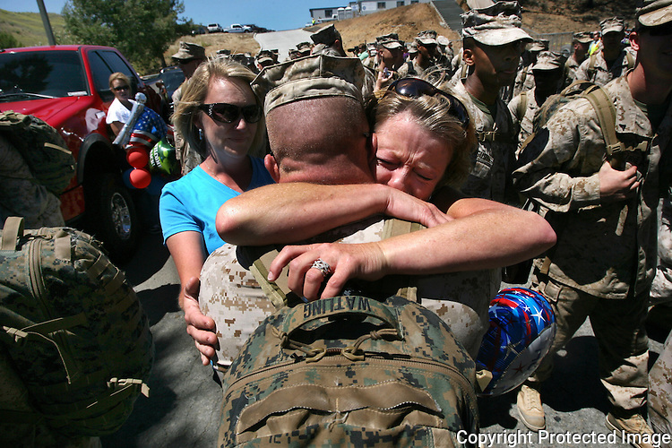 Marine Sgt. Matthew Watling receives a heartfelt embrace from his mother, Rebecca Johnson, in August, 2010, at Camp Pendleton, California, upon his unit's return from Afghanistan.  photo for North County Times