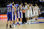 Real Madrid´s players change a ball with Anadolu Efes´s players during 2014-15 Euroleague Basketball Playoffs second match between Real Madrid and Anadolu Efes at Palacio de los Deportes stadium in Madrid, Spain. April 17, 2015. (ALTERPHOTOS/Luis Fernandez)