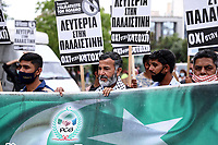 Pictured: Anti-Israel protesters in Athens, Greece. Saturday 15 May 2021<br /> Re: Palestinian people living in Greece, joined by local supporters protesting against Israel, have clashed with police in central Athens, Greece.