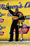 Jeff Arend (Funny Car) and his daughter in the winners circle after winning the O'Reilly Auto Parts Spring Nationals at the Royal Purple Raceway in Baytown,Texas.