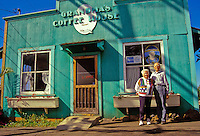 A senior couple poses in front of Grandma's Coffee House in Keokea in upcountry Maui.