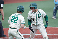 David McCabe (24) of the Charlotte 49ers celebrates with teammate Dominic Pilolli (22) after scoring a run during the game against the Old Dominion Monarchs at Hayes Stadium on April 25, 2021 in Charlotte, North Carolina. (Brian Westerholt/Four Seam Images)