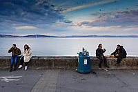 Pictured: People enjoy a drink and eating food outdoors in Mumbles. Friday 16 April 2021<br /> Re: People enjoy an evening out after Covid-19 lockdown rules were relaxed, in Swansea Bay, Wales, UK.