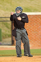 Home plate umpire Josh Reep makes a strike call during the NCAA baseball game between the Charlotte 49ers and the High Point Panthers at Willard Stadium on February 20, 2013 in High Point, North Carolina.  The 49ers defeated the Panthers 12-3.  (Brian Westerholt/Four Seam Images)