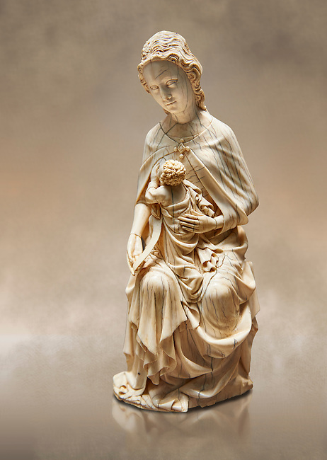"""Medieval Gothic ivory statuette of the Virgin and Child known as """"a La Supplique"""" (supplication) made in Paris oat the beginning of the the 15th century.  inv 2745, The Louvre Museum, Paris."""
