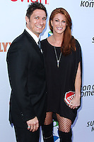 SANTA MONICA, CA, USA - JUNE 11: Carl Ferro, Angie Everhart at the Pathway To The Cures For Breast Cancer: A Fundraiser Benefiting Susan G. Komen held at the Barker Hangar on June 11, 2014 in Santa Monica, California, United States. (Photo by Xavier Collin/Celebrity Monitor)