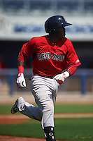 GCL Red Sox shortstop Luis Alejandro Basabe (18) runs to first during the first game of a doubleheader against the GCL Rays on August 4, 2015 at Charlotte Sports Park in Port Charlotte, Florida.  GCL Red Sox defeated the GCL Rays 10-2.  (Mike Janes/Four Seam Images)