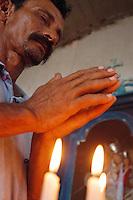 Vaqueiro reza na capela da fazenda Arari ao começar o dia.<br /> Cachoeira do Arari, Pará, Brasil.<br /> 08/05/2006<br /> Foto Paulo Santos/Interfoto