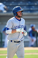 Mikey White (5) of the Stockton Ports runs to first base during a game against the Rancho Cucamonga Quakes at LoanMart Field on May 28, 2017 in Rancho Cucamonga, California. Stockton defeated Rancho Cucamonga, 7-4. (Larry Goren/Four Seam Images)