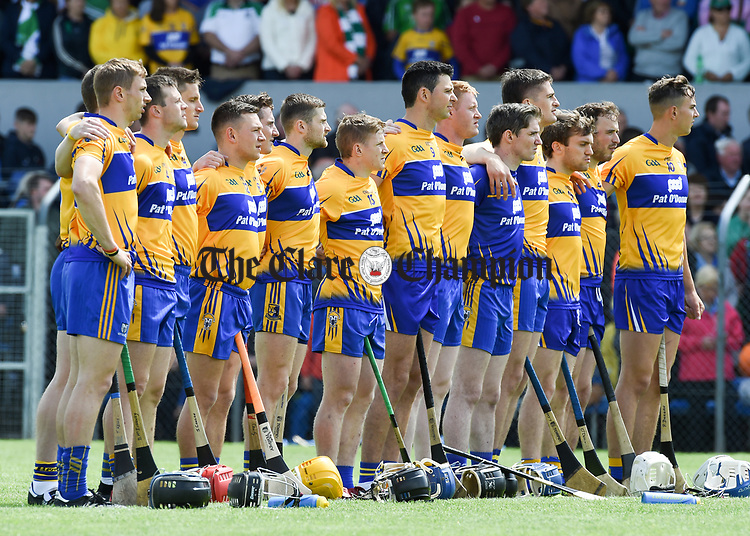 Clare players stand for the anthem before their Munster championship game against Clarecastle in Ennis. Photograph by John Kelly.