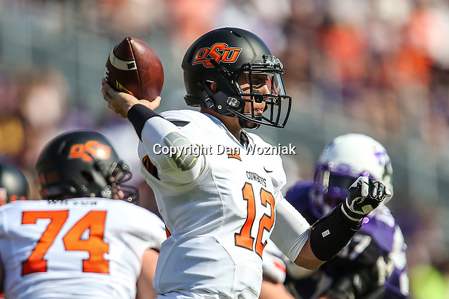 Oklahoma State Cowboys quarterback Daxx Garman (12) in action during the game between the OSU Cowboys and the TCU Horned Frogs at the Amon G. Carter Stadium in Fort Worth, Texas. TCU defeated OSU 42 to 9.
