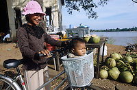 CAMBODIA Mekong River, woman with child and bicycle / KAMBODSCHA Mekong Fluss, Frau mit Kind und Fahrrad