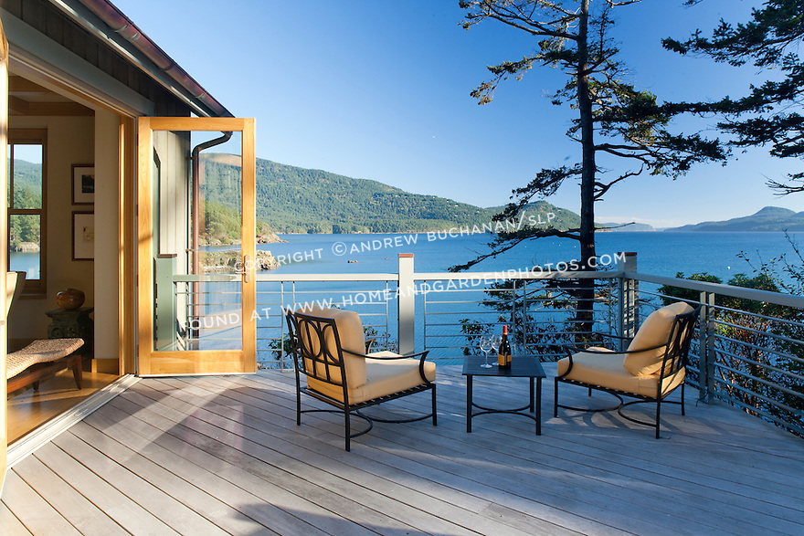 French doors open onto an expansive deck with beautiful water views.