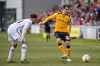 Tommy O'Sullivan of Newport County passes away from Wes Atkinson of Notts Countyduring the Sky Bet League 2 match between Newport County and Notts County at Rodney Parade, Newport, Wales on 30 April 2016. Photo by Mark  Hawkins / PRiME Media Images.
