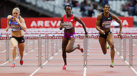 06 JUL 2012 - PARIS, FRA - Tiffany Porter of Great Britain (centre) races Sally Pearson (left) and Virginia Crawford (right) to the finish line  during the women's 100m Hurdles at the 2012 Meeting Areva in the Stade de France in Paris, France (PHOTO (C) 2012 NIGEL FARROW)