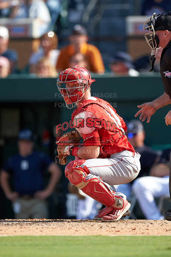 Florida Southern Moccasins catcher Kevin Fuller (14) checks the runner during an exhibition game against the Detroit Tigers on February 29, 2016 at Joker Marchant Stadium in Lakeland, Florida.  Detroit defeated Florida Southern 7-2.  (Mike Janes/Four Seam Images)