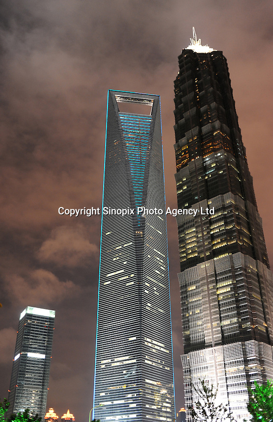 The Shanghai China World Financial Center (left) which stands at 492 meters, next to the Jin Mao Tower(right, 420.5 meters) Shanghai, China. Shanghai China World Financial Center (SWFC) is a super-tall skyscraper in Pudong, is mixed use skyscraper which consists of offices, hotels,conference rooms, and shopping malls on the ground floors. The Jin Mao Tower is an 88-story landmark skyscraper in Luijazui area of Pudong..