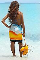 Aldris Santana holding a string of coconuts at Maho Bay.Virgin Islands National Park.St. John, U.S. Virgin Islands