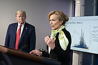 President Donald J. Trump listens as White House Coronavirus Response Coordinator Dr. Deborah Birx delivers remarks during a coronavirus update briefing Thursday, April 16, 2020, in the James S. Brady Press Briefing Room of the White House.<br /> <br /> People:  President Donald Trump,  Dr. Deborah Birx