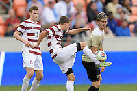 Houston, TX - Friday December 11, 2016: Jared Gilbey (15) of the Stanford Cardinal clears the ball in front of Ian Harkes (16) of the Wake Forest Demon Deacons at the NCAA Men's Soccer Finals at BBVA Compass Stadium in Houston Texas.