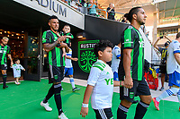 AUSTIN, TX - JUNE 19: Julio Cascante #18 of the Austin FC and son enters the pitch before a game between San Jose Earthquakes and Austin FC at Q2 Stadium on June 19, 2021 in Austin, Texas.