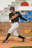 Edinho Meyer #23 of the Bluefield Orioles follows through on his swing versus the Johnson City Cardinals at Howard Johnson Field August 1, 2009 in Johnson City, Tennessee. (Photo by Brian Westerholt / Four Seam Images)