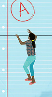 Girl climbing sheet of lined paper to reach A grade ExclusiveImage