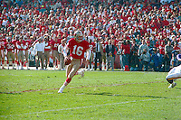SAN FRANCISCO, CA - Quarterback Joe Montana of the San Francisco 49ers runs with the football during a game at Candlestick Park in San Francisco, California in 1991. Photo by Brad Mangin