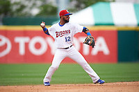 Buffalo Bisons shortstop Alexi Casilla (12) throws to first during a game against the Louisville Bats on June 23, 2016 at Coca-Cola Field in Buffalo, New York.  Buffalo defeated Louisville 9-6.  (Mike Janes/Four Seam Images)