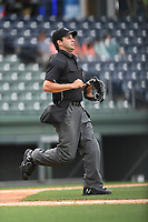 Umpire Jude Koury works a game between the Augusta GreenJackets and the Greenville Drive on Wednesday, April 25, 2018, at Fluor Field at the West End in Greenville, South Carolina. Augusta won, 9-2. (Tom Priddy/Four Seam Images)